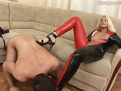 Latex mistress fucks slave
