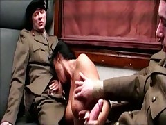 Italian Lady in train with three soldiers