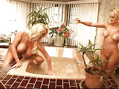 Busty blondes in bathtub