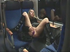 Blonde masturbating and fucking on train