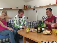Partying guys seduce slutty blonde granny and nail her