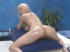 Big tit blonde isn't shy at her massage