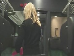 Cute Blonde playing on the train