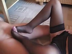 Footjob in black nylons